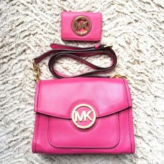 Michael Kors Fulton Crossbody AND Card Holder 100% authentic Michael Kors Fulton Crossbody AND small credit card holder/wallet included!!. This gorgeous crossbody is HOT PINK. Just like Barbie! It was carried ONE time and is in near perfect condition. The interior is flawless and the outer leather is in excellent condition. The gold MK logo on the front has a few VERY light dusting scratches that are barely visible. The credit card holder/small wallet had a few more visible scratches on the…