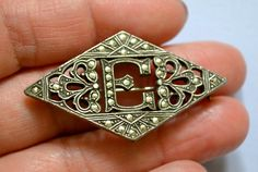 "Art Deco Brooch, Antique Silver Tone, Marcasite, Letter ""E"", Estate Sale, Item No.S254. $17.50, via Etsy."