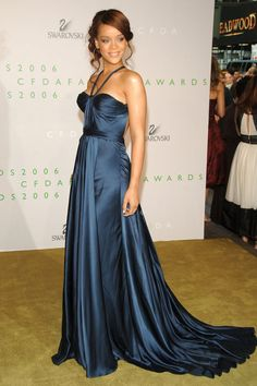 In 2006, Rihanna wore a midnight blue Max Azria gown with her hair in a sweet undone updo.   - HarpersBAZAAR.com