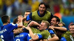 Italy secure slim win over England Goals from Claudio Marchisio and Mario Balotelli proved enough for Italy to beat England 2-1 in an entertaining game in Manaus.