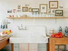 love the shelf above the kitchen sink.. and the sink.