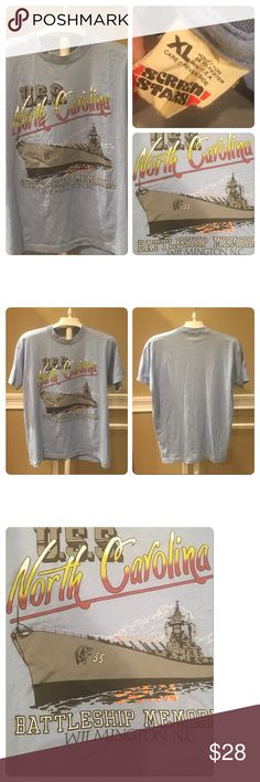 Vintage USS North Carolina Tourist/souvenir Tee Vintage  USS North Carolina Wilmington Battle Ship T Shirt Baby Blue. Printed on a Screen Stars 50-50 poly cotton T-shirt. No holes no stains no rips no tears. Tag reads extra large best for medium /large. Depending on desired fit. Feel free to ask for measurements Vintage Tops Tees - Short Sleeve