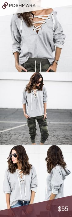 Lace Up Hoodie Top Lace up hoodie sweater top. Runs true to size. Model is wearing the size small. Bare Anthology Tops Blouses