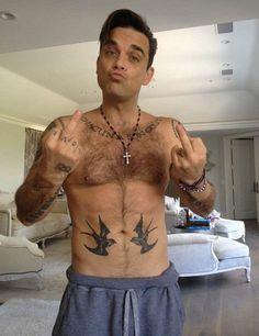 Robbie Williams en colère contre les paparazzis