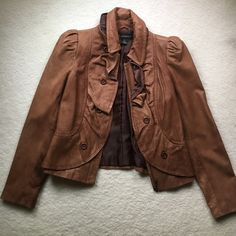 I🎉🎉HP 7/6/2016 🎉🎉 Inc leather jacket.  NWOT Caramel colored leather jacket with ruffle and button detail. zips up the front and feels like butter on. Very soft 100% leather jacket by Inc.  ( never worn) INC International Concepts Jackets & Coats Utility Jackets