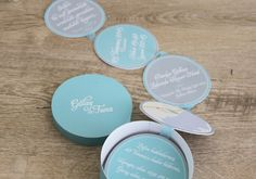 """Circles of Love"" wedding invitation in a mint green cylindrical box"