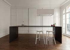 Dutch studio i29 has designed a minimal stainless-steel kitchen island for a classical Paris apartment.