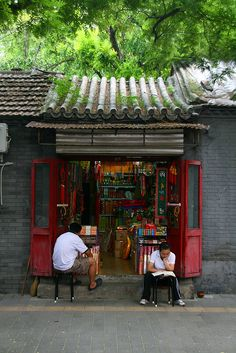 Waiting for customers, Hutong shop Beijing China