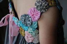Adorable dress adorned with yo yo's.