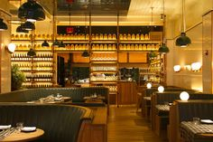 Roman and Williams New York City restaurant design for Upland with leather, wood, and copper interior - Photo by Susan Getzendanner