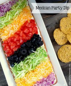 Mexican Party Dip _ Always a huge hit with any crowd! Arrange the toppings in rows as compared to just piling the toppings on. The presentation always wows! Serve with tortilla or corn chips for dipping.