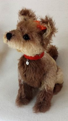 Daisy Mohair dog, Jointed at neck and hind legs Created with two styles of German mohair and has German glass eyes. Hand embroidered nose. Contact bearlycollectibles@hotmail.com.