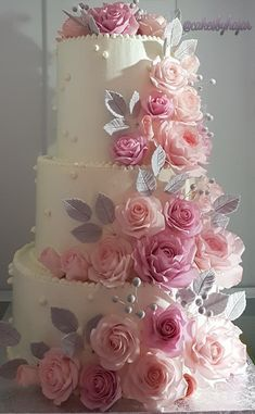 3 tier white wedding cake decorated with gumpaste roses in many shades of pink and silver leaves. Amazing Wedding Cakes, Elegant Wedding Cakes, Wedding Cake Designs, Cake Wedding, Wedding Cakes With Cupcakes, Fun Cupcakes, Cupcake Cakes, Cake Cookies, Flower Cupcakes