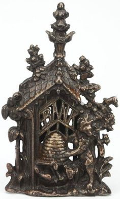2116: Cast Iron Bee Hive Still Bank. : Lot 2116 - very much like the one I have.  Different details