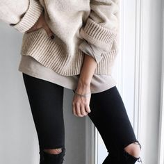 Relaxed cosy outfit. Ripped skinny black jeans and oversized knit oatmeal jumper