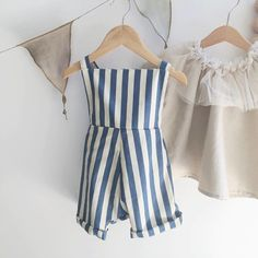 Our beautiful NEW Stripe Linen Jimmy Rompers are meticulously handmade locally in Western Australia. We have sourced the best quality Linen fabric and designed these to sit perfectly on little legs and backs! Perfect for Spring and Summer or just layer with a long sleeve Tshirt or cardigan for the cooler months! Each romper features Tan Leather tab detail and now has adjustable straps at the back to ensure a perfect fit!NOTE: Stripe rompers are in stock
