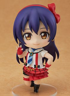"**""I'll capture everyone's hearts!""**    From the popular anime series 'LoveLive!' comes a Nendoroid of the diligent and hardworking beauty, Umi Sonoda! She has been sculpted wearing her outfit used in the song 'Bokura wa Ima no Naka de' and comes with both a relaxed smiling expression and a blowing kiss expression! She also comes with a large number of parts that allow you to recreate the danc..."