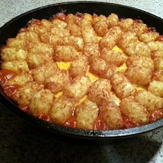 Sloppy Joe Tater Tot Casserole: swap out velveeta for real cheese, use organic potato puffs and maybe this won't be quiet as unhealthy.