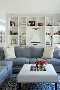 Elegant beach house cottage living room with gray sofa.... very clean looking with a more modern vibe.