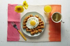 Tater tots are great. Waffles are great. So one can assume that tater tot waffles are even better, right? Right! Follow the recipe after the cut for a fun new way to eat tots. Your waffle iron will appreciate the extra love.