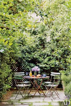 Breakfast awaits beneath a towering magnolia in the Paris garden of two decorative-arts dealers.