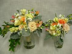 Soft summer toned Bride and Maid of Honor wedding bouquets. Created with Sahara roses, Finesse roses, white stock, lysimachia, yellow lisianthus, dusty miller, white freesia peach sweet pea and passioin flower vine accents in the brides bouquet.