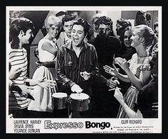 EXPRESSO BONGO 1959 movie on DVD. Complete, un-cut. Includes all scenes that have been cut on every release, including musical performances and strip club, near-nude scenes.Expresso Bongo rivals some of the best U.S. rock and roll movies. Cliff Richard is discovered singing in a coffee bar.