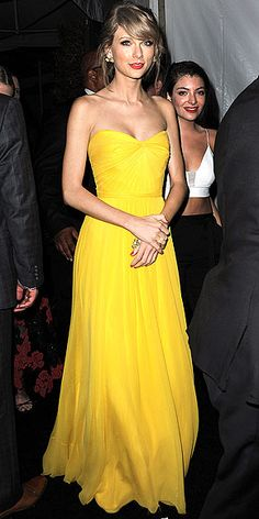 Taylor Swift in a (possibly Beauty and the Beast inspired??) bright yellow gown after the Golden Globes.