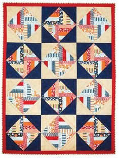 """Sports fans will love this easy bed size quilt pattern Game Day that uses 2 1/2"""" pre-cut strips."""