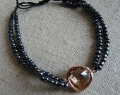 Navy blue beads with peach glass charm with rose gold casing £18.00
