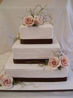 three-tier square wedding cake white pinkkk rosesfrosted
