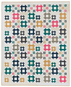 What makes this eye-catching Churn Dash quilt shine? Solids! Varying block sizes changing throughout the quilt adds to its liveliness too - designed by Amy Ellis, featured in the book I Love Churn Dashes.