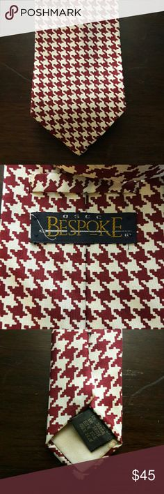 OSCC Bespoke Necktie This awesome Bespoke necktie is a wine and ivory color. It is made of 100 % silk. Classic, contemporary, stylish, timeless. In great condition. Bespoke Accessories Ties