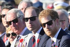 Prince William (C) and Prince Charles and Prince Harry