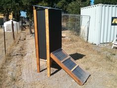 Solar dehydrator system with redwood structure and recycled aluminum can radiator. Twelve one square foot trays for drying.
