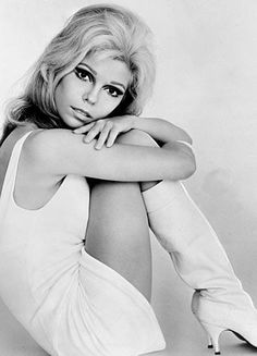"Nancy Sandra Sinatra (born June 8, 1940) is an American singer and actress. She is the daughter of singer/actor Frank Sinatra, and remains best known for her 1966 signature hit ""These Boots Are Made for Walkin'""."
