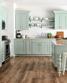 Martha Stewart cabinets - I like the open shelving between cabinets, over the sink.