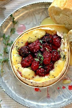 Blackberry Thyme Baked Cheese! Make with Camembert and Brie, made with roasted blackberries. A beautiful and delicious appetizer or wine pairing!   The Cookie Rookie