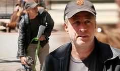I've got you, buddy! Heart-melting scenes as Jon Stewart reassures his tired three-legged pup during daily walk