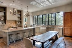 Look at those wonderful wide-plank wood floors -- and the stunning windows!