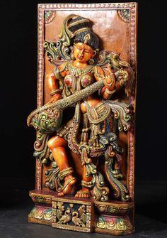 Panel made of painted mango tree wood depicting a radiant Goddess Saraswathi dancing and playing her veena