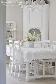 Alright so I'm typically not a fan of formal dinig rooms, but I would do this. Love all the white!