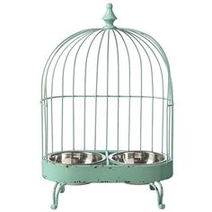 HA!!!    Re-purposing is all the rage for a bird cage! Charming aqua metal bird cage design is halved to accommodate a food and water bowl for a cat that appreciates the irony. Curvaceous feet and a finial on ...
