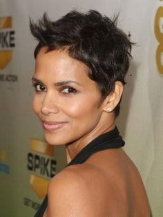 Smooth with just a touch of wave at the ends, Halle Berry's layered hairstyle is so versatile. Her swirling fringe adds a trendy touch to the look.