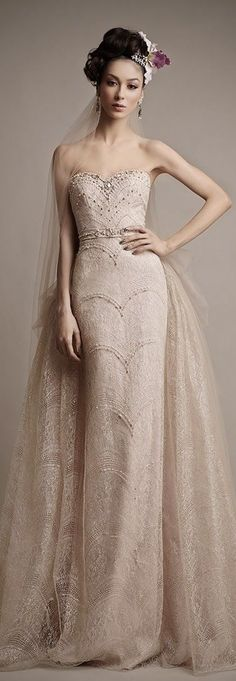 Ersa Atelier 2015 Bridal. The sheath is a little too simple for me, but I love the billowing wide bustle!