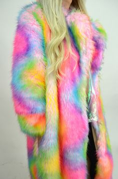 Oversized faux fur rainbow coat. Large colar, gathers all around. Lined with pockets. Length: 55in Width: 26in Custom length available through custom order. Please email jackedfashionclothing@gmail.com *This coat will take 3 to 4 weeks as it is made to order for you.