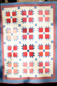 Vintage inspired group quilt, Bear's Paw design.  Each quilter embroidered her name on a block. Seen at Thimbleanna