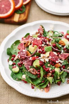 BABY SPINACH SALAD WITH BLOOD ORANGES:  3 cups of baby spinach,  2 medium blood oranges,  ½ cup pomegranate seeds,  1 avocado,  ¼ cup pecans,  ½ red onion,  1 tablespoon lime juice,  ¼ cup of crumbled feta cheese,  1-tablespoon extra virgin olive oil,  ½ teaspoon sea salt,  ¼ teaspoon black pepper, freshly ground