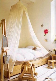 shabby chic girls room with sheer bed canopy