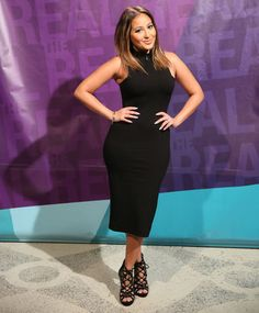 Adrienne is making a statement in a Nasty Gal dress and Sam Edelman heels.